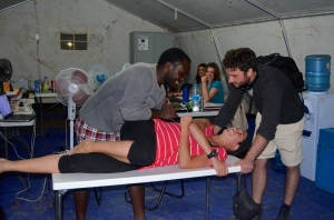 Tent-based physiotherapy: working on my SI joint problems... Thanks, Handicap International!